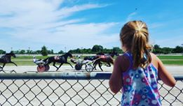 Watching the horses race from the fence